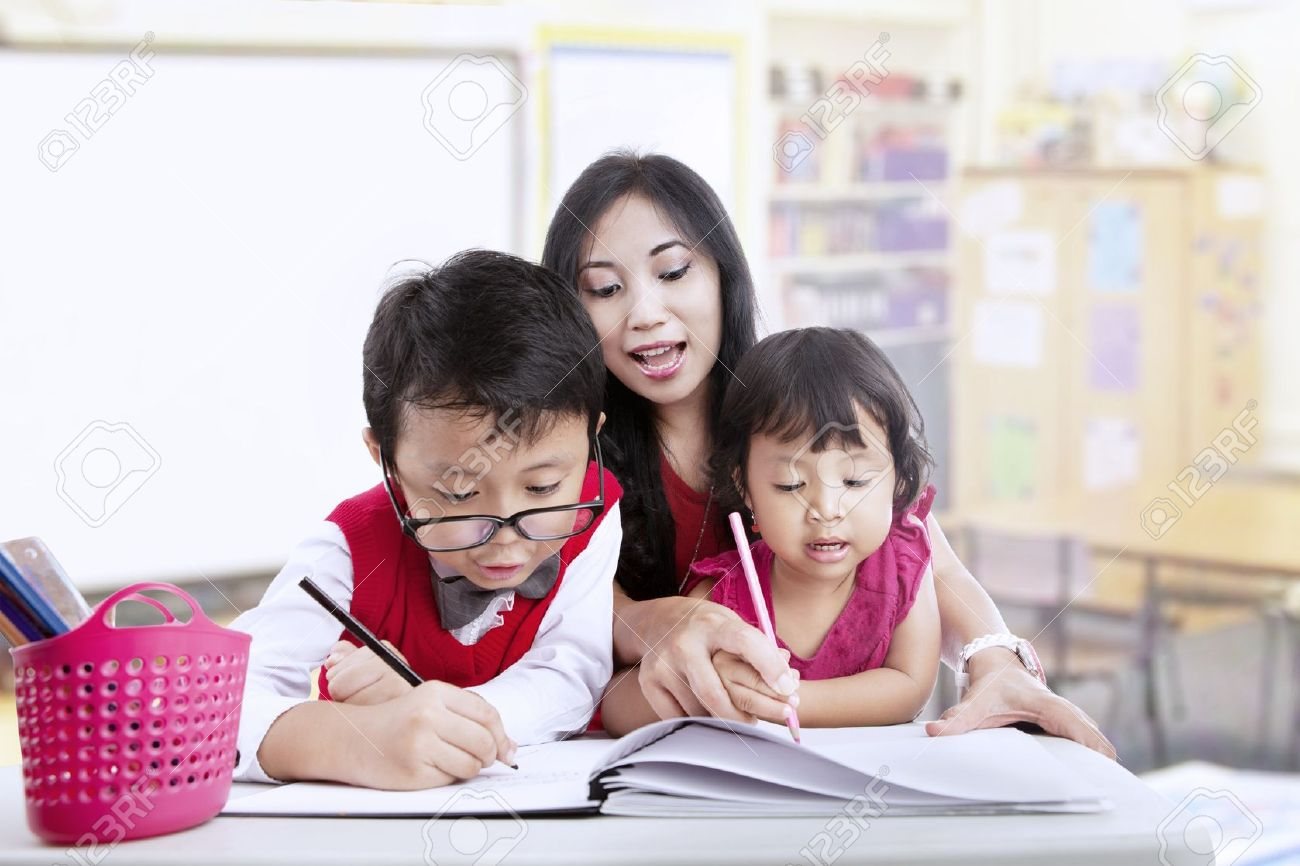16823532 teacher and children study in classroom together stock photo asian